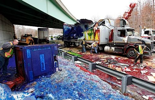 Overturned ink-carrying tractor-trailer paints the town red